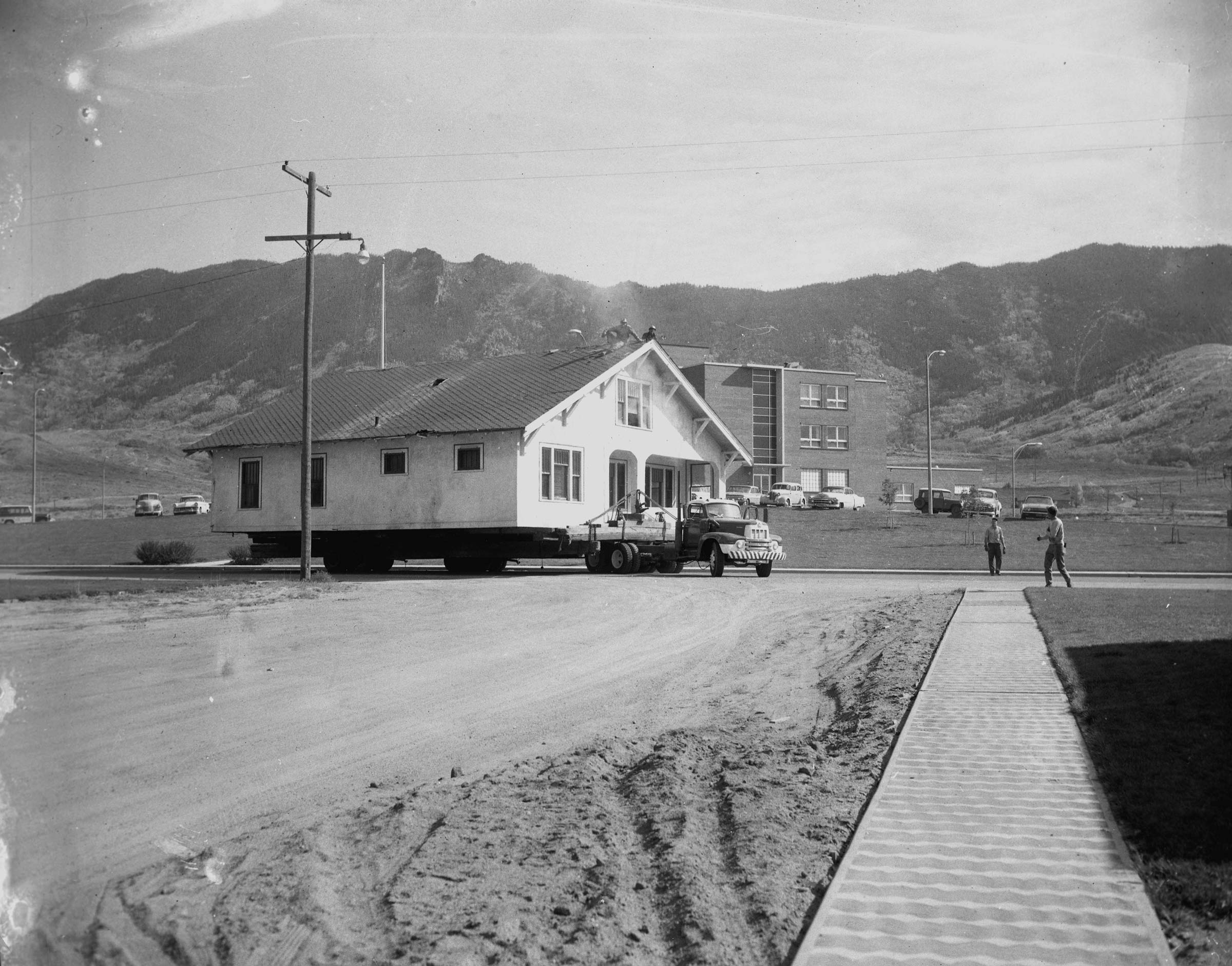 Houses being moved out of Meaderville to make way for expansion of the Berkeley Pit. Photo courtesy of the Butte-Silver Bow Public Archives.